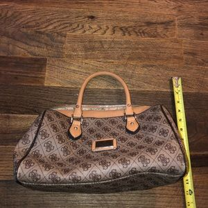 One brown and tan guess purse